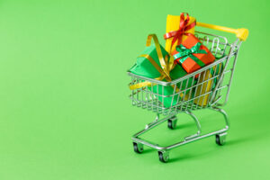 A mini shopping cart with presents in it